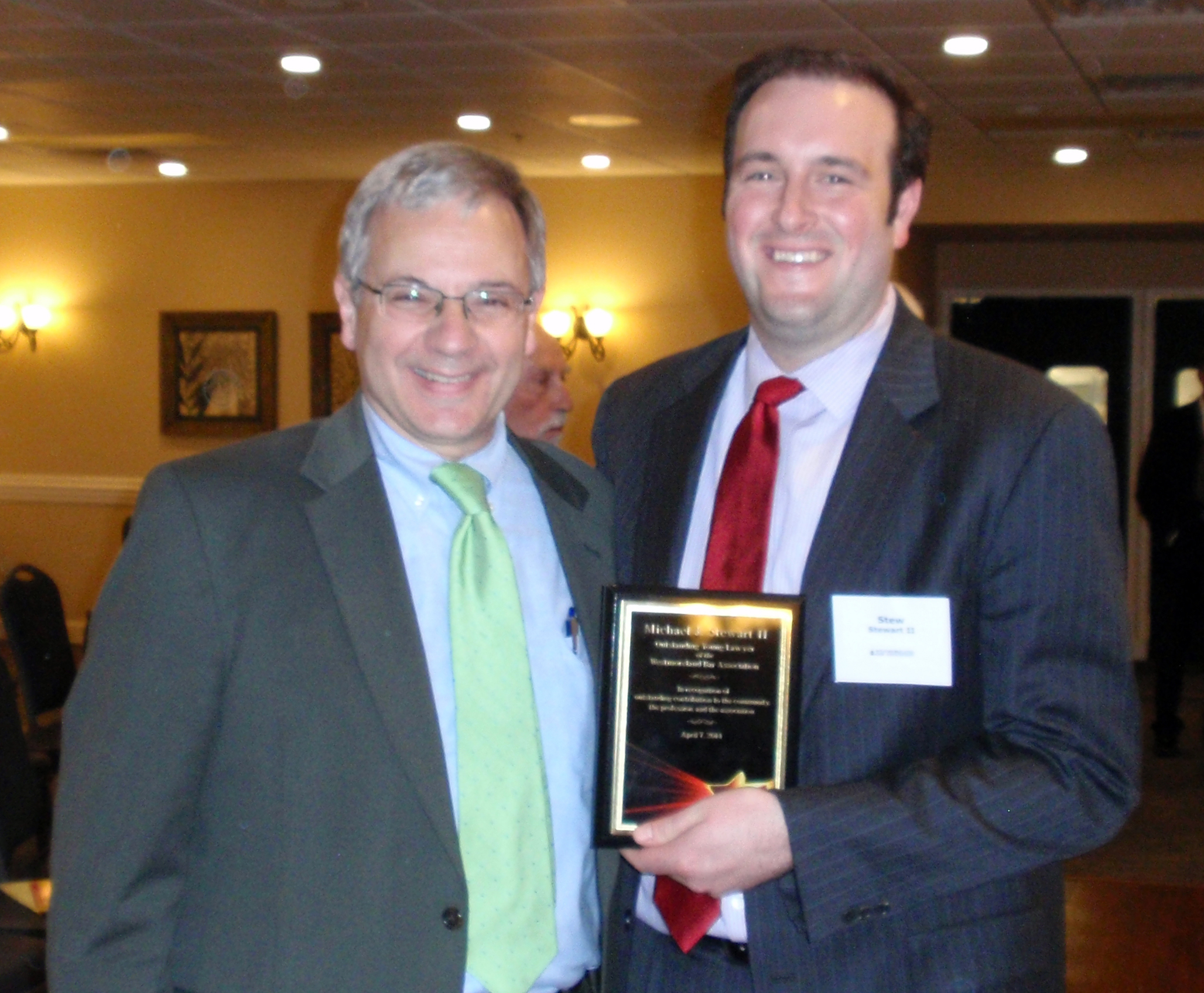 WBA Past President David DeRose awards the 2014 Outstanding Young Lawyer Award to Michael J. Stewart II