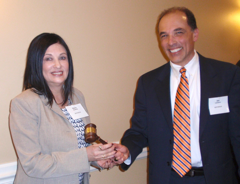 WBA President Maria E. Soohey accepts the ceremonial gavel from Past President Joseph W. Lazzaro