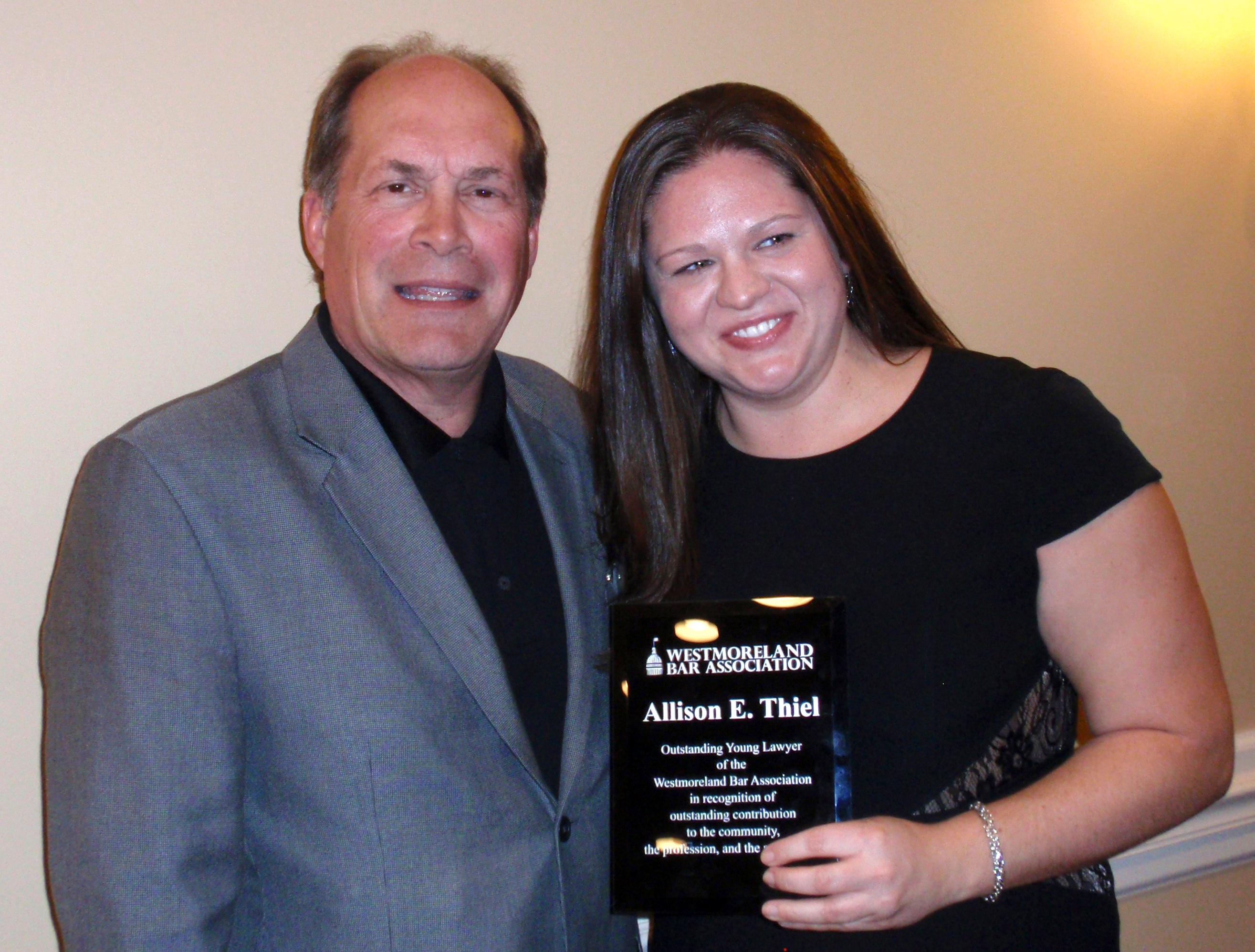 WBA President-Elect John M. Noble awards the 2015 Outstanding Young Lawyer Award to Allison Thiel